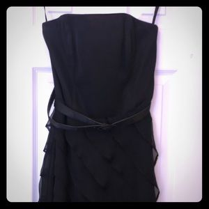 Strapless black cocktail dress with ruffle skirt
